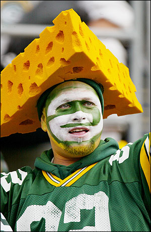 A Green Bay Packer Cheese Head Fan...