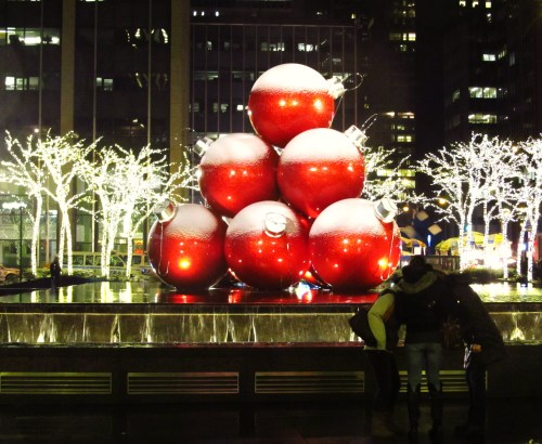 Christmas is: A helping hand at the brightly lit water fountain on 6th Ave