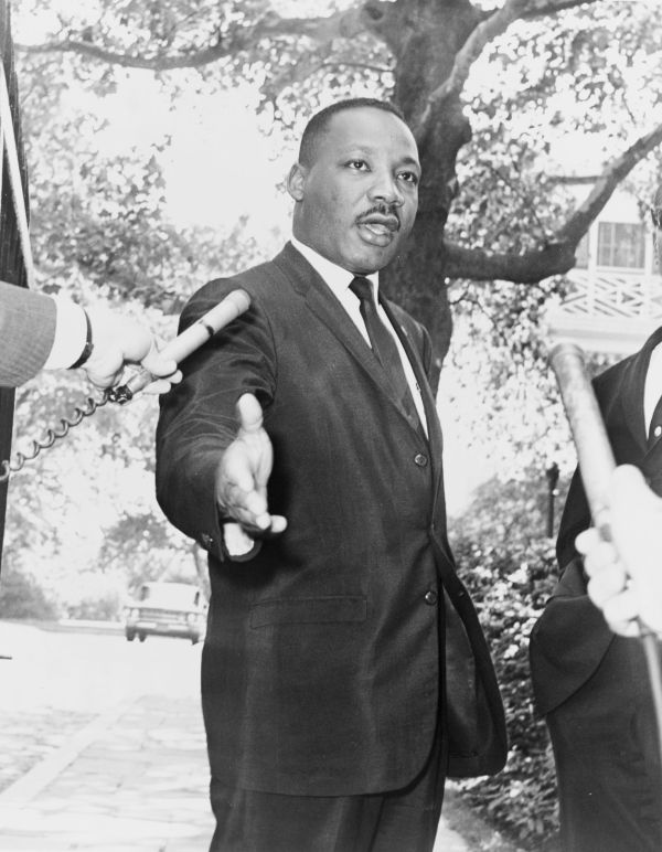 Dr. M. L. King holding a press conference outside Gracie Mansion, New York 1964