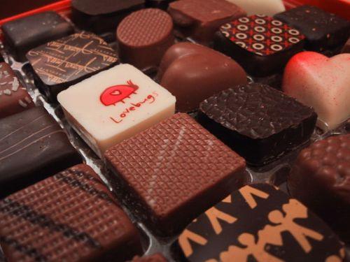 Three valentines day wishes and chocolates