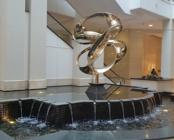 Weekly Photo Challenge: WEIGHT(LESS) - Floating Rings on a Water Fountain